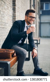 Handsome businessman enjoying on pause and drinking coffee to go