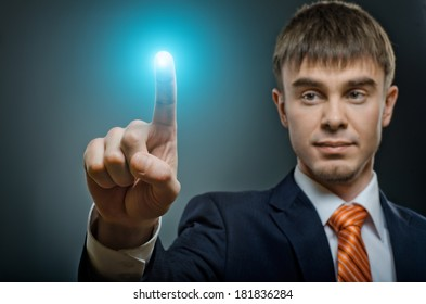 handsome businessman  finger point touch, on dark blue background