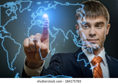 handsome businessman  finger point touch on world map, on dark blue background