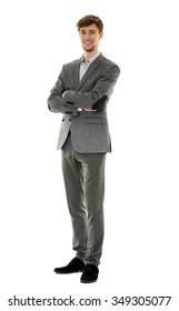 Handsome businessman full length portrait isolated on white