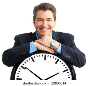 Handsome businessman holding the clock. Over white
