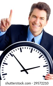 Handsome businessman holding a clock. Over white background