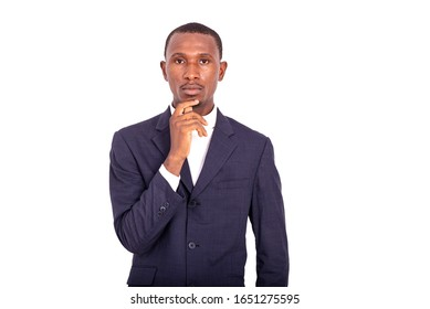 handsome businessman in jacket standing on white background thinking hand under chin.