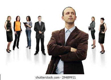 Handsome Businessman Leader of large group of business people - all in focus - at  stuff meeting isolated on white background. Check my portfolio for more