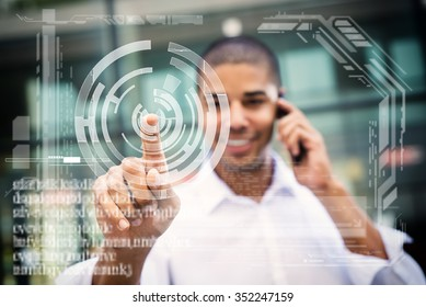 Handsome businessman pointing finger to camera and slicking virtual button, finger is in focus while his face is out of focus. Shallow depth of field.