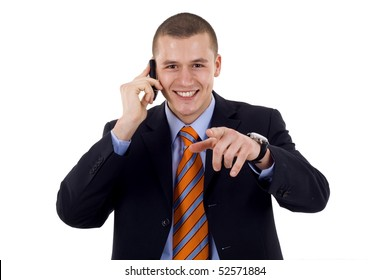 A handsome businessman pointing with finger while talking on the phone. All on white background.