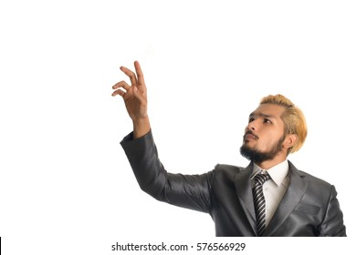 Handsome businessman pointing something isolated on white background.