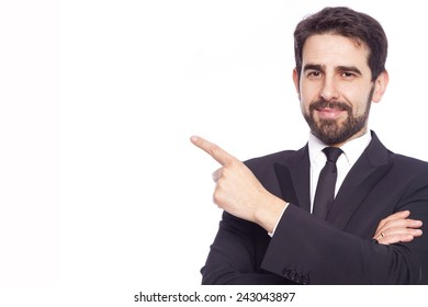 Handsome businessman pointing up, isolated on white background
