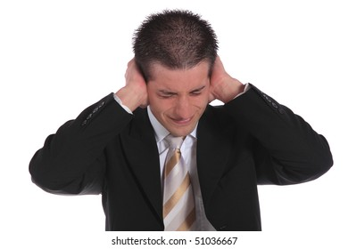 A handsome businessman pressing his hands on his ears. All on white background.
