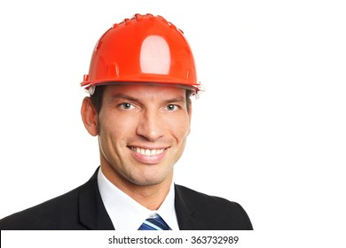 Handsome businessman in a protective helmet, right you can write some text