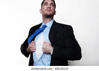 handsome businessman pulling his shirt apart doing a superhero businessman poses