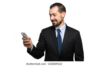 Handsome businessman reading a message on his smartphone, isolated on white