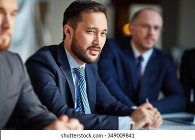 Handsome businessman sitting at a meeting