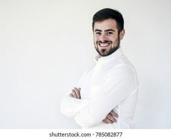 Handsome businessman smiling with arms crossed - isolated, white background