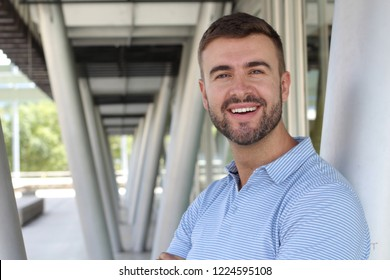 Handsome businessman smiling with copy space