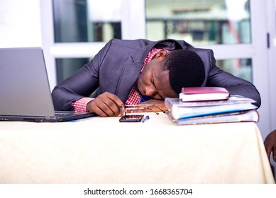 handsome businessman in suit sitting at desk while sleeping.