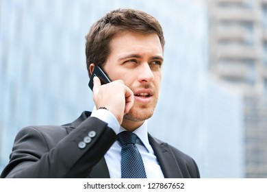 Handsome businessman talking on the cellphone