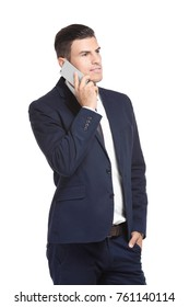 Handsome businessman talking on mobile phone against white background