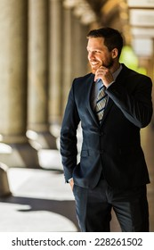 Handsome businessman thinking ahead and smiling