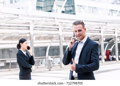 Handsome businessman using his smartphone