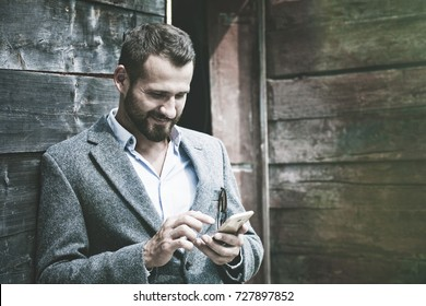 Handsome businessman using smart phone