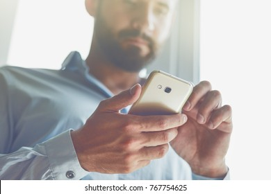 Handsome businessman using smart phone
