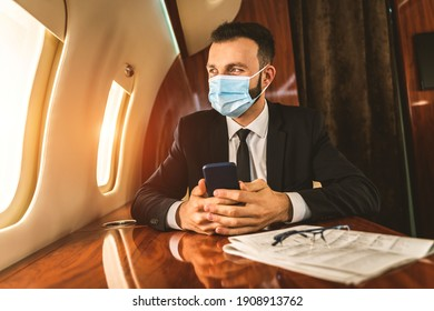 Handsome businessman wearing elegant suit  flying on exclusive private jet - Successful entrepreneur sitting in exclusive business class on airplane, concepts about business and trasportation