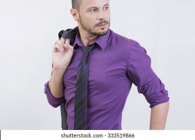 Handsome businessman wearing a purple shirt in studio