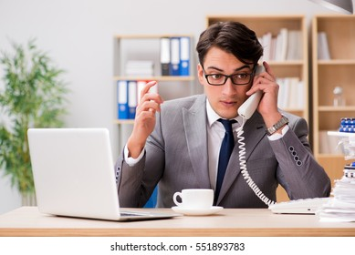 Handsome businessman working in the office