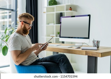 Handsome businessman working on a computer in an office.