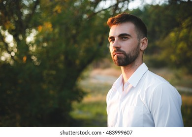 Handsome casual bearded man in white t-shirt