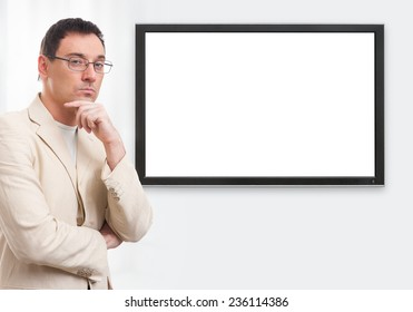 handsome casual businessman and digital panel with blank screen