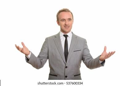 Handsome Caucasian businessman giving speech