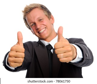 Handsome caucasian executive in business suit gives the thumbs up; selective focus on hands