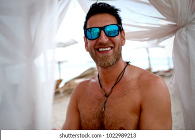Handsome Caucasian Male Portrait with Bright Smile and Sunglasses Outdoor