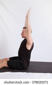 Handsome Caucasian man in a yoga position