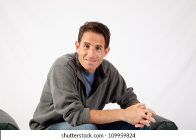Handsome Caucasian mature man with eye contact and a thoughtful, pensive expression
