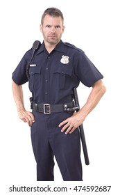 Handsome Caucasian police officer wearing cop uniform stands with authority and bold eyes on white background