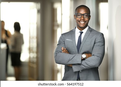 Handsome cheerful african american executive business man at the workspace office