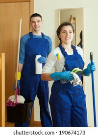 Handsome cleaners cleaning room at home