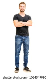 Handsome confidance. Studio full length portrait of young man in casual wear with hands crossed. Isolated on white.