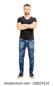Handsome confidence. Studio full length portrait of young man in casual wear with hands crossed. Isolated on white.