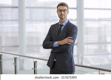 Handsome confident businessman with glasses portrait