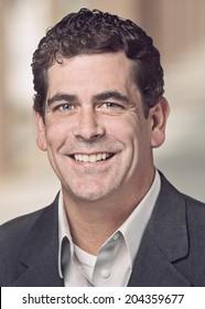 Handsome confident businessman headshot portrait