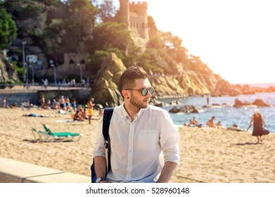 6c6308005ce51a Handsome and confident hipster man in sun glasses with modern haircut and  beard