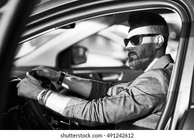 Handsome confident man in the car
