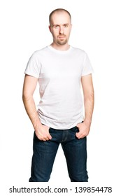 Handsome confident man in white t-shirt and blue jeans isolated on white
