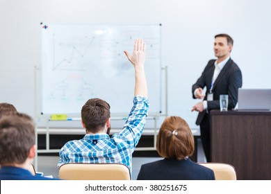 Handsome confident teacher lecturing and tallking to students in univercity