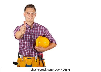 Handsome construction worker with yellow tool belt and helmet showing thumbs up on isolated