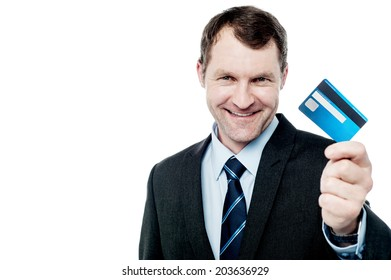 Handsome corporate man showing his credit card
